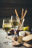 White wine with charcuterie assortment on the stone background stock photos