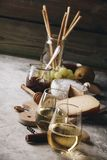 White wine with charcuterie assortment on the stone background stock photo