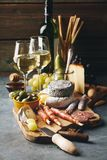 White wine with charcuterie assortment on the stone background stock photography