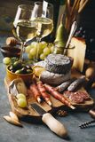 White wine with charcuterie assortment on the stone background royalty free stock image