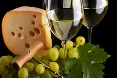 White wine and cheese on black Stock Image