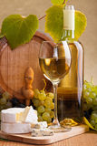 White wine with cheese and white grape snack Royalty Free Stock Image
