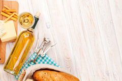 White wine, cheese and bread on white wooden table background Royalty Free Stock Image