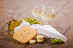 White wine and cheese composition. Various sorts of cheese and white wine royalty free stock images