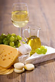 White wine and cheese composition. Various sorts of cheese and white wine stock photo