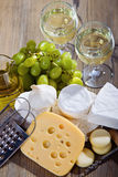 White wine and cheese composition. Various sorts of cheese and white wine royalty free stock photography