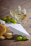 White wine and cheese composition. Various sorts of cheese and white wine royalty free stock image