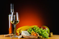 White wine, cheese and fruits Royalty Free Stock Image