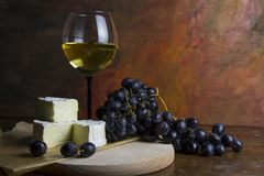 White wine with cheese and grapes royalty free stock photo