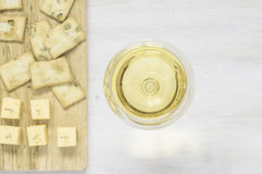 White wine with cheese and snacks Royalty Free Stock Photography