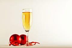 White wine and christmas balls Stock Image