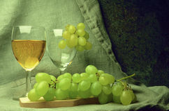 White wine composition with grapes Stock Images