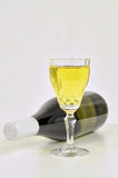 White wine in crystal glass and a bottle Royalty Free Stock Images