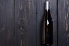 White wine on dark wood Royalty Free Stock Image