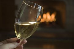 White Wine By the Fire Royalty Free Stock Image