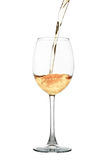 White wine flowing into a glass isolated on white Royalty Free Stock Photography