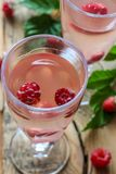 White wine with fresh raspberries. Raspberry cocktail Stock Images