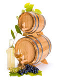 White wine in front of stacked barrels Royalty Free Stock Image