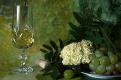 White wine with fruits and flower Stock Photo