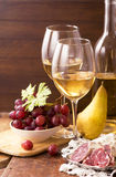 White wine and fruits Royalty Free Stock Image