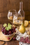 White wine and fruits Stock Images