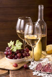 White wine and fruits Stock Image