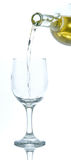 White wine glass. White wine being poured into a glass Royalty Free Stock Image
