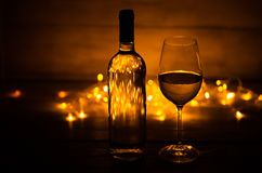 White wine glass against Christmas lights Royalty Free Stock Photography