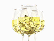 White wine in a glass. On a white background Royalty Free Stock Photography