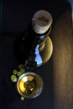White wine glass and bottle Stock Images