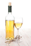 White wine glass, bottle and corkscrew Royalty Free Stock Images