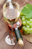 White wine glass, bottle and grapes Stock Photos