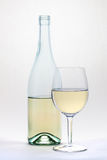 White wine glass and bottle islolated on white background. White wine half full glass and bottle islolated on white background stock photos