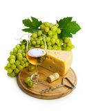 White wine in a glass c cheese and grapes Royalty Free Stock Photography