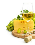 White wine in a glass c cheese and grapes Stock Photography