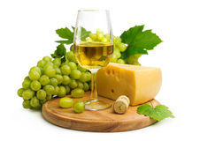 White wine in a glass c cheese and grapes Stock Photos