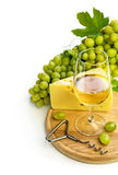 White wine in a glass c cheese and grapes Royalty Free Stock Images
