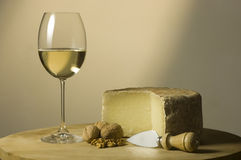 White wine glass and cheese royalty free stock photography