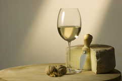 White wine glass and cheese royalty free stock photos