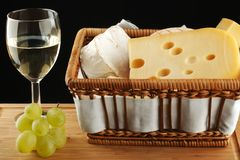 White wine in glass with cheese and grape Stock Image