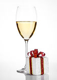 White wine glass with christmas gift box. Decoration  on white background Royalty Free Stock Image