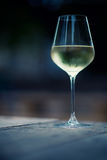 White wine in a glass. Color image of chilled white wine in a glass , with copy space royalty free stock photos