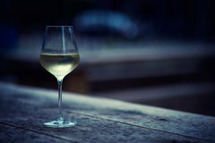 White wine in a glass. Color image of chilled white wine in a glass , with copy space royalty free stock photography