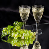 White wine in glass with grape Royalty Free Stock Images