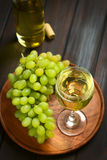 White Wine in Glass with Grapes Royalty Free Stock Image