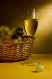 White wine in a glass and grapes Royalty Free Stock Photos