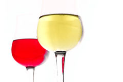White wine in a glass on red wine background. Selective focus Royalty Free Stock Photos