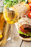 White wine glass, sandwiches and salad Stock Photo