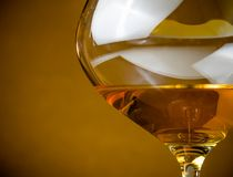 White wine into a glass with space for text, warm atmosphere Stock Photography