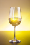 White wine glass on wooden table Stock Photo